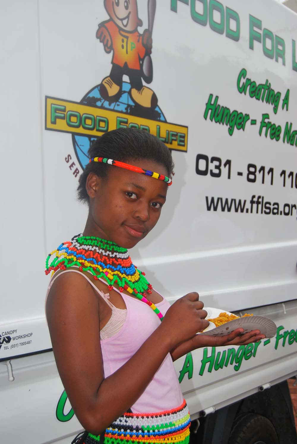 Pretty Neliswa Ralarala, 13 years in grade 7 at Nomzamo Mandela Primary in Welbedacht East, in her traditional finery